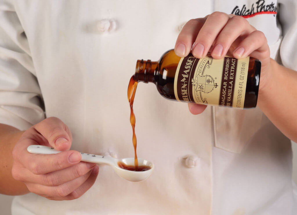 Pouring Vanilla into Measuring Spoon